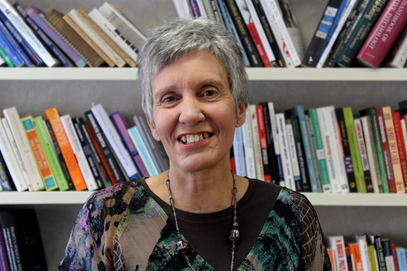 Professor Niki Harre standing in front of bookcase