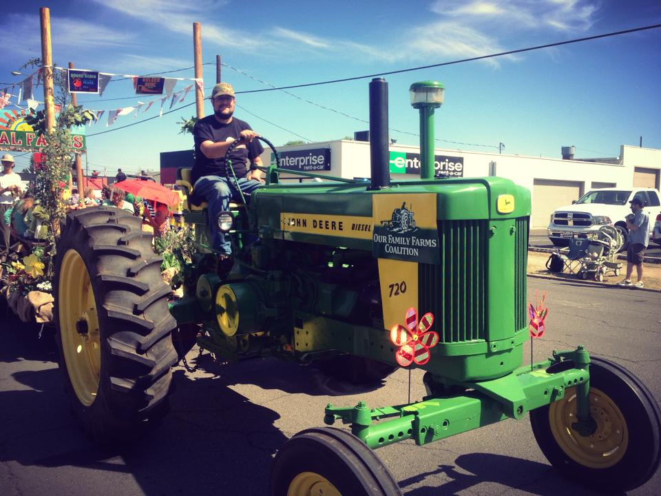 Jared_on_tractor_in_parade.jpg