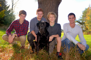 Jonathan today with his 3 older brothers and service dog, Cagney