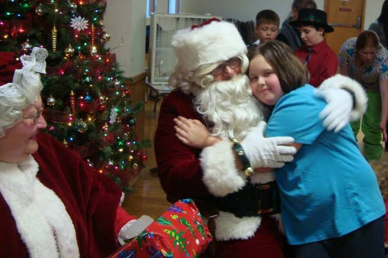HOR_-_elks_kids_party_Santa_and_little_girl_hugging..jpg