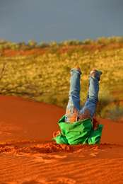 Playing in the sandhills at Ourdel Station, Windorah by Helen Commens