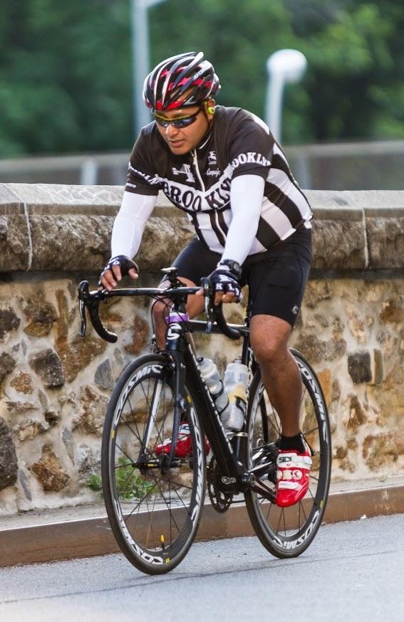 Man on bike, pedalling hard
