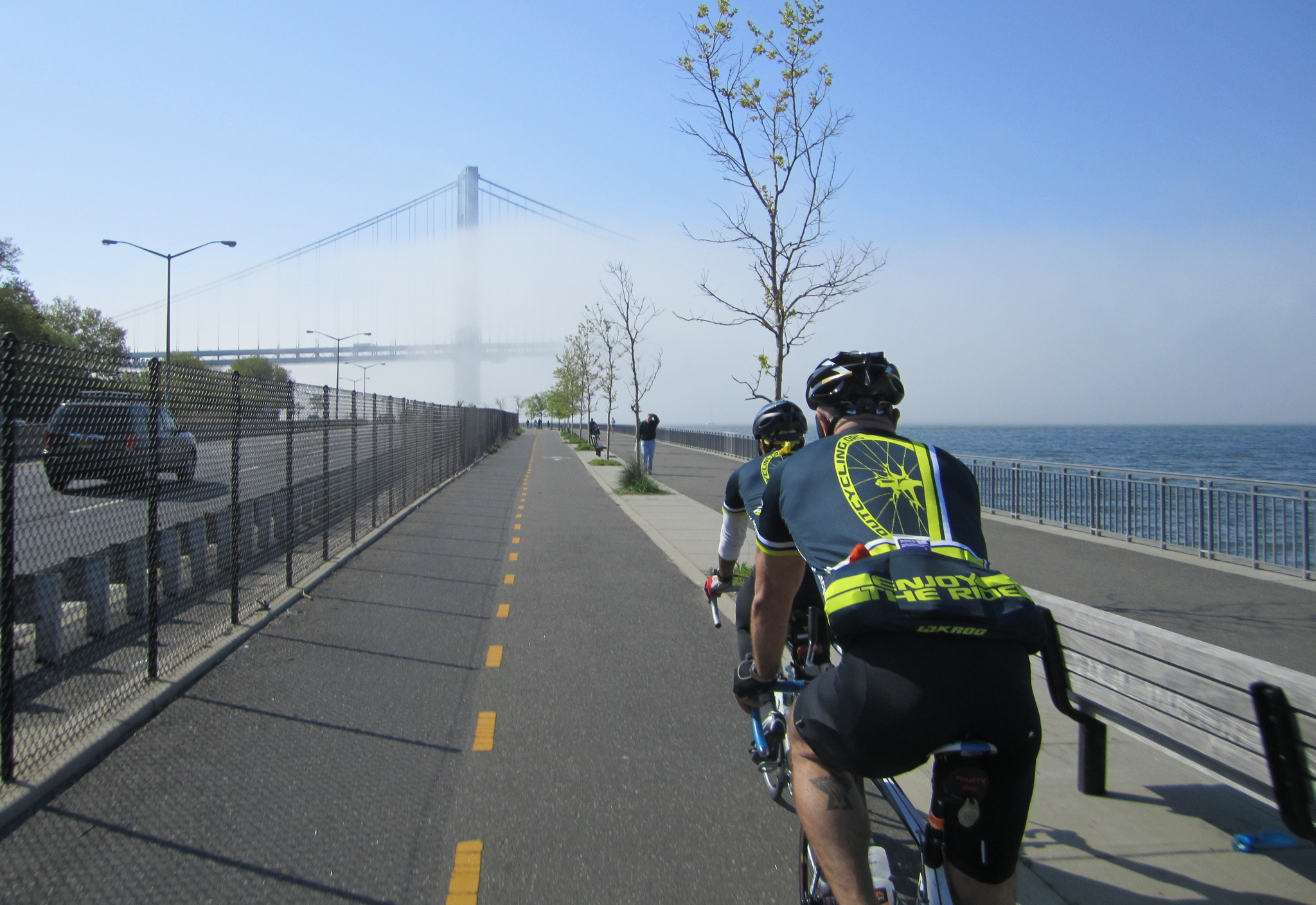 Bikers with the Verrazano Bridge in the background