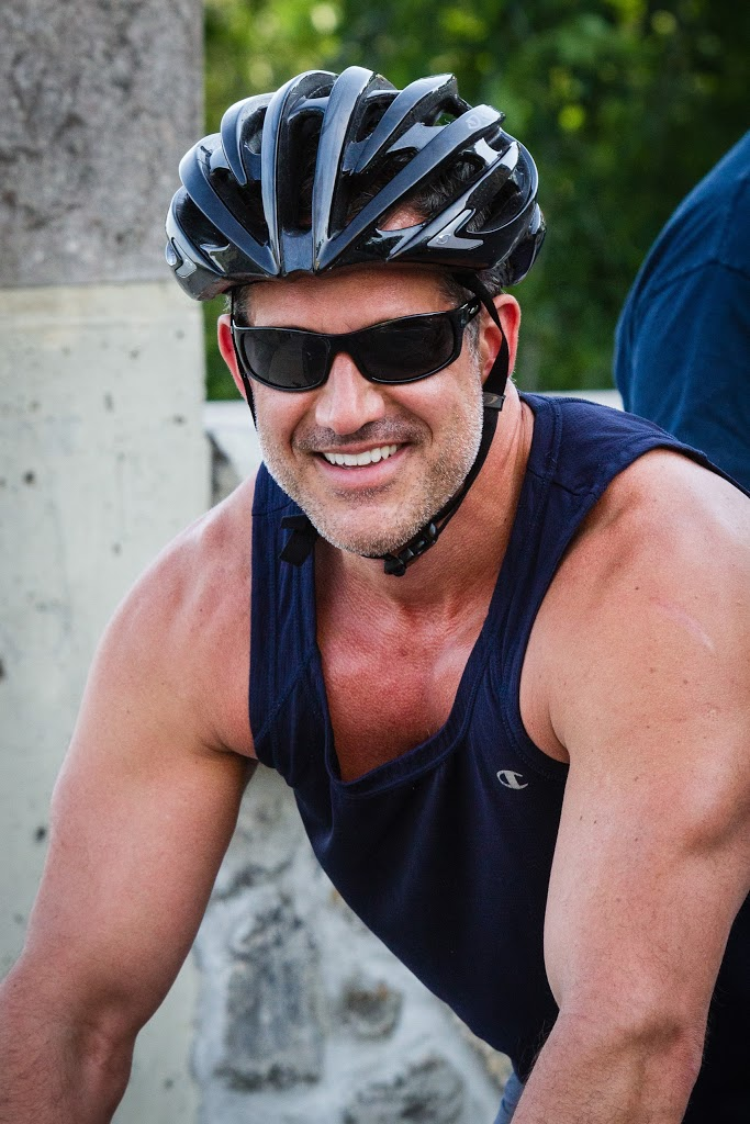 Muscular biker with helmet and tanktop