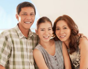 A happy Asian family smiling and posing for photographing.