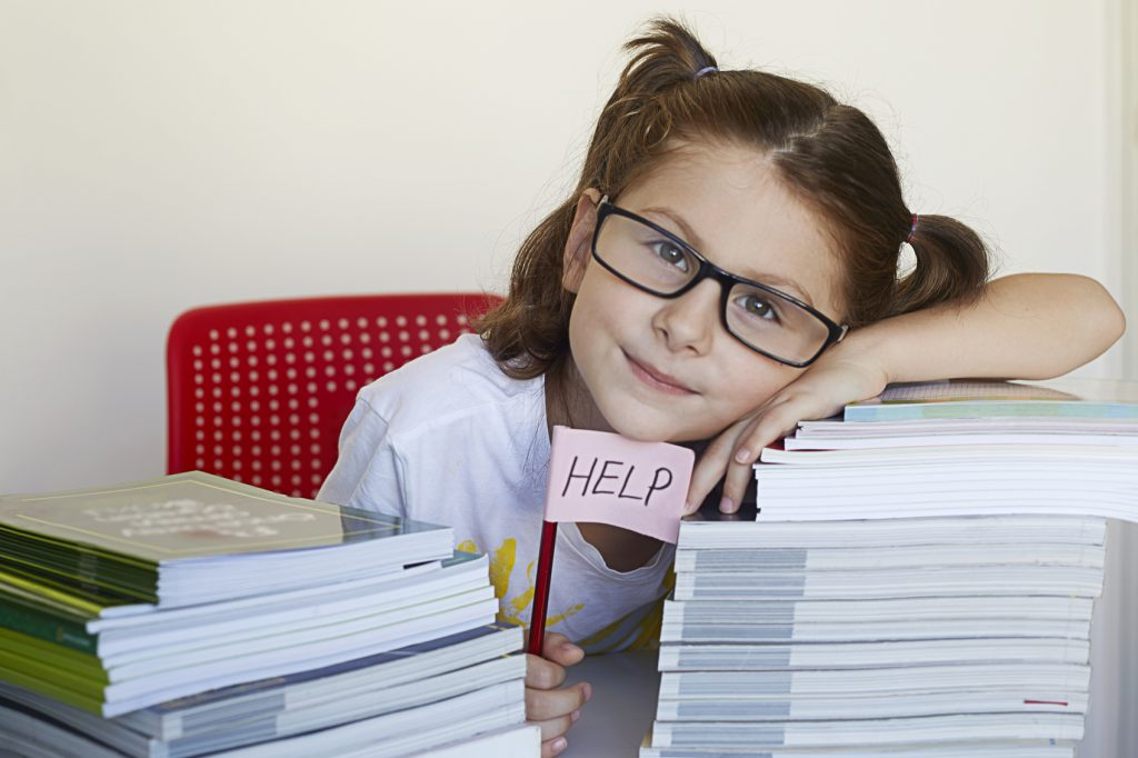 Little girl has a lot to study and asking for help.