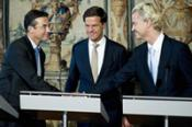 Leader of the Dutch Christian party CDA Maxime Verhagen shakes hands with leader