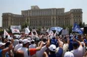 Romanian protestors gather outside parliament headquarters in Bucharest