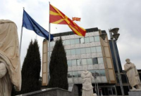 Macedonian and EU flags in front of the Government building in the capitol Skopj