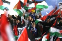 Palestinians celebrate in Ramallah after the General Assembly voted to recognise
