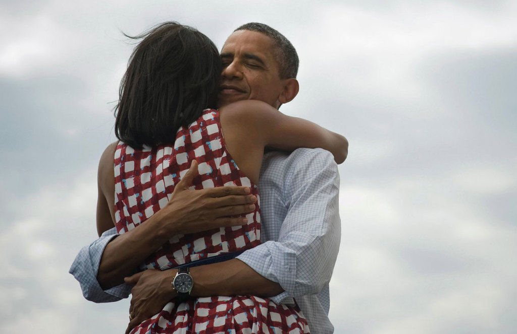 President-Barack-Obama-hugs-his-wife-Michelle-after-she-introduces-him-at-a-campaign-event-at-the-Village-of-East-Davenport-in-Davenport-Iowa-on-August-15-2012.-In-November-this-image-was-attached-to-a-short-message-sent-by-B-1024x663.jpg