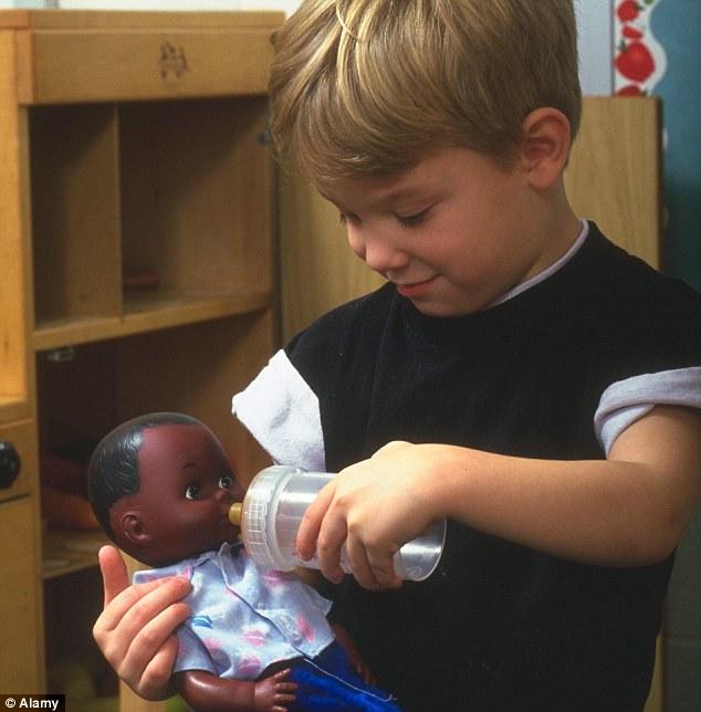 White boy with black doll