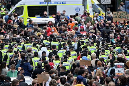 Left wing mob surround Home Office van