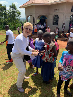 Paula greeting students in Mpigi, Uganda