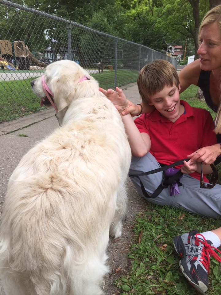 Autism service dog going to a boy who is blind