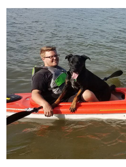 Xander the service dog in a kayak