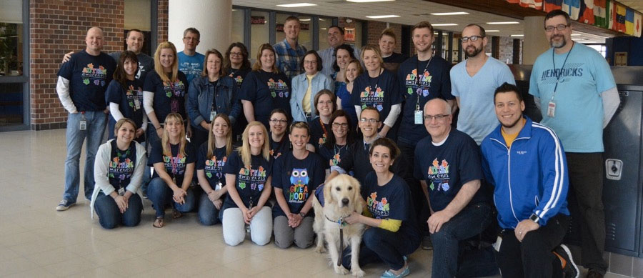 Olaf the Therapy Dog with teachers