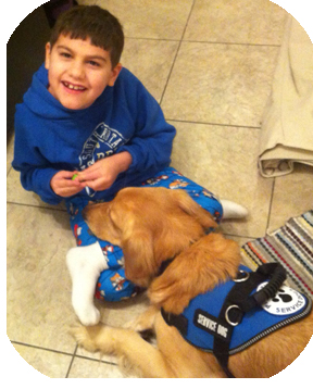 Boy with LKS and his service dog