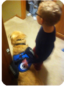 Boy and his autism service dog