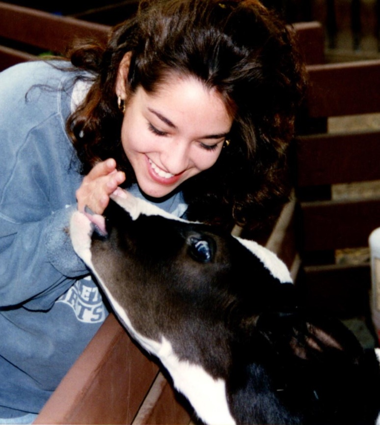 Shala with a baby cow.