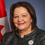 Hon. Rose-May Poirier