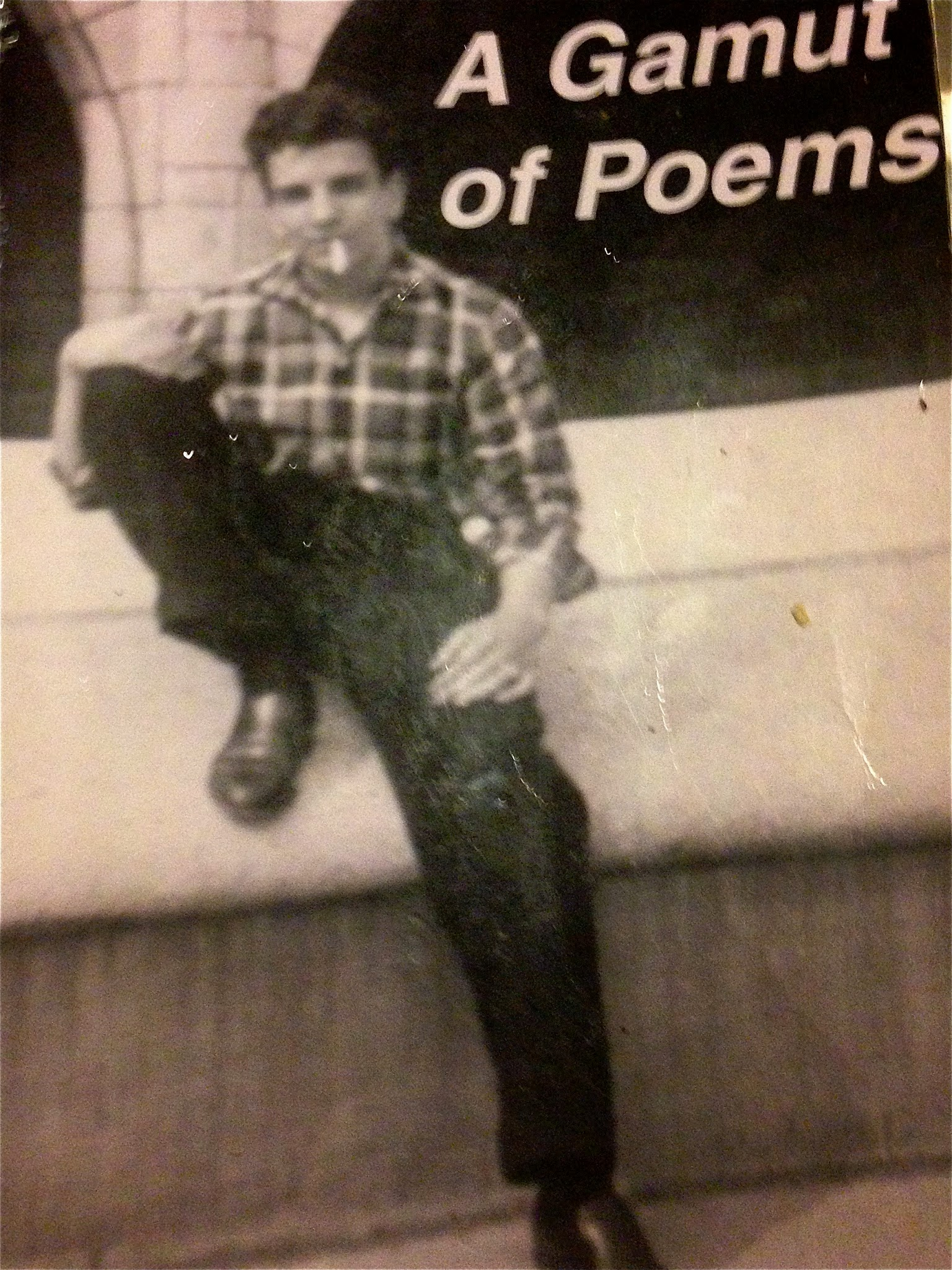 A photo of Vinny back in the day graces his book of poetry.