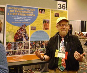 Tony Rajer posing for a picture beside his poster presentation on the Nek Chand Foundation at the AIC annual conference in Milwaukee, 2010. Image provided by Jason Church.