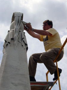 Jason Church taking color measurement on the Macomb monument at Congressional Cemetery in Washington, D.C. Image provided by Jason Church.