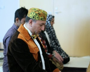 Photograph of seated muslims from Queer and Muslim: Finding Peace Within Islam.