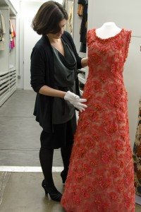Clare Sauro with an evening dress designed by Givenchy and donated to the DHCC by Princess Grace of Monaco. The entire dress is embroidered with genuine coral branches that make a delightful tinkling sound when moved. Courtesy of the Drexel Historic Costume Collection, Drexel University.