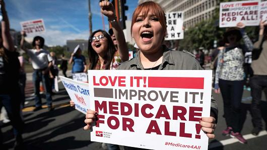 medicareforall_rally_girl_104490351-GettyImages-633888868.530x298.jpg