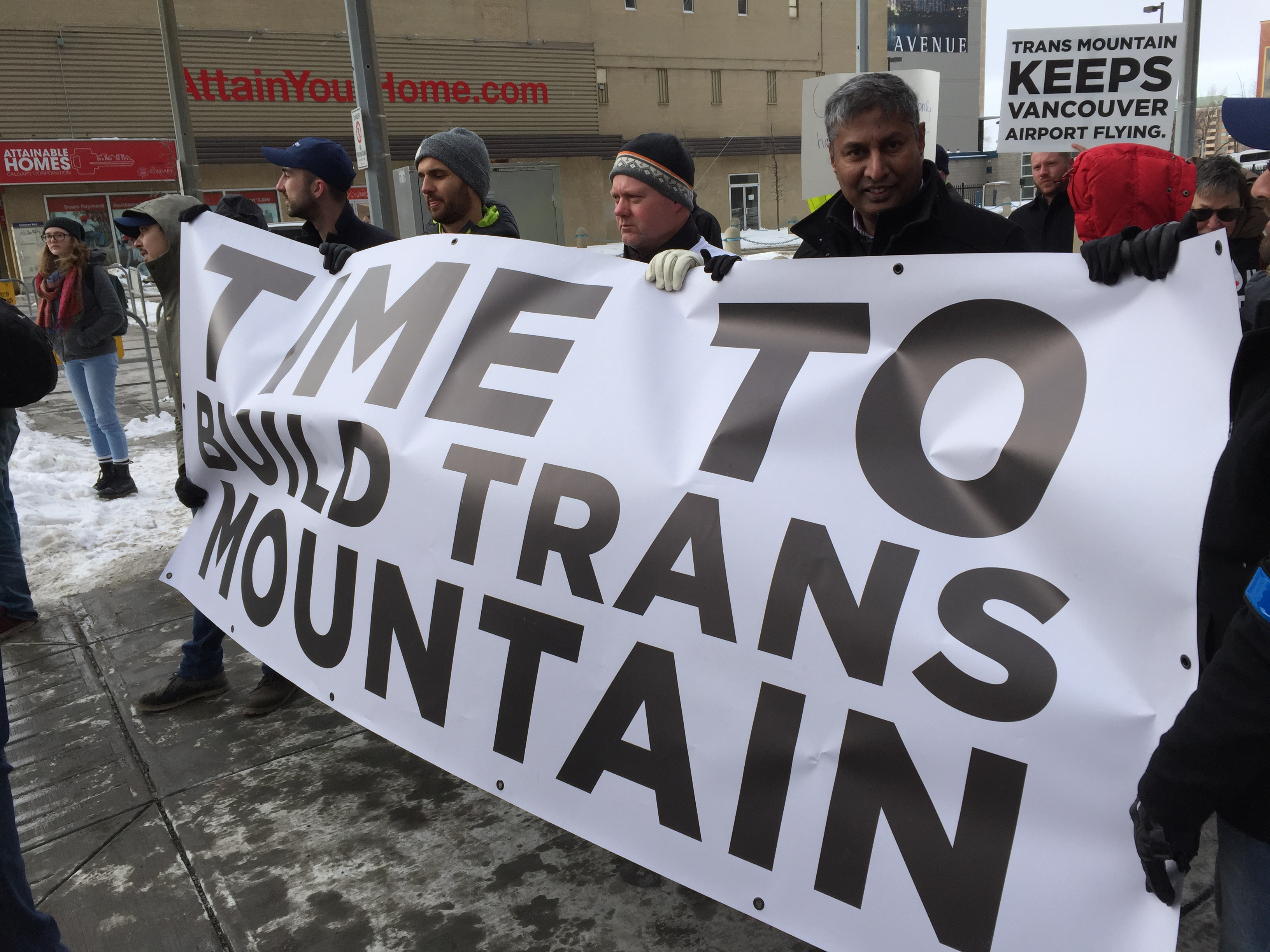 https://d3n8a8pro7vhmx.cloudfront.net/prasadpanda/pages/13/features/original/Attending_a_Rally_for_the_Trans_Mountain_Pipeline.JPG?1525821063