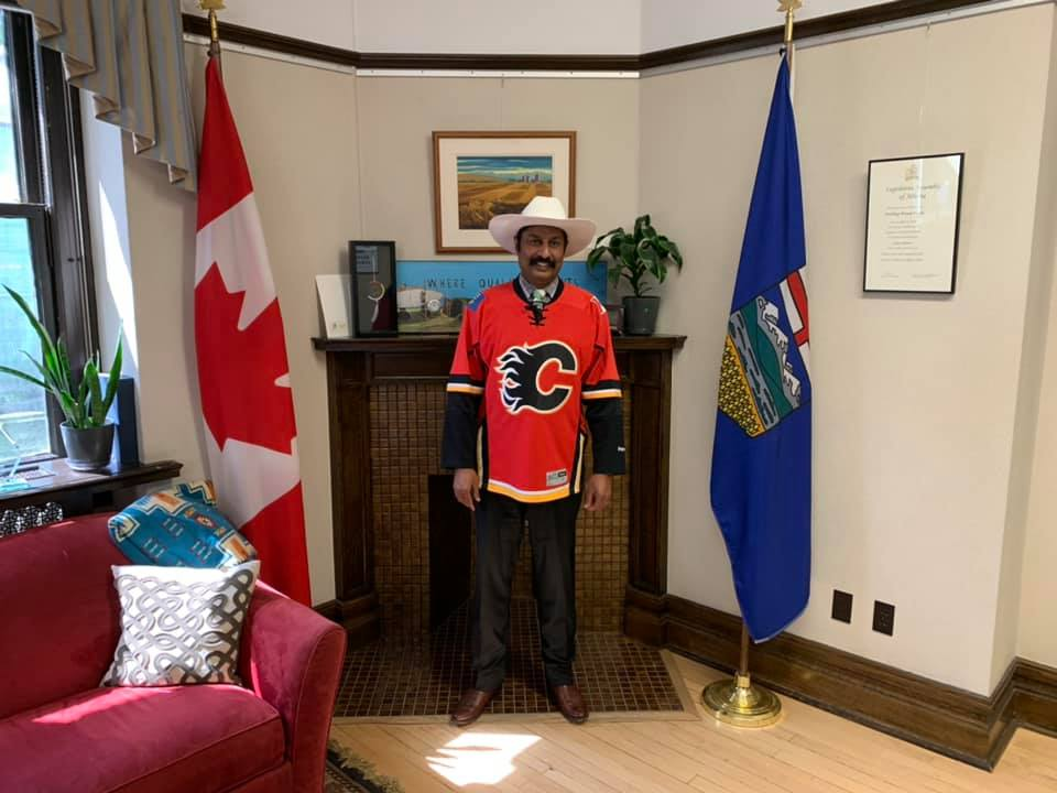 https://d3n8a8pro7vhmx.cloudfront.net/prasadpanda/pages/13/features/original/Cheering_on_Calgary_in_the_Legislature.jpg?1612979173
