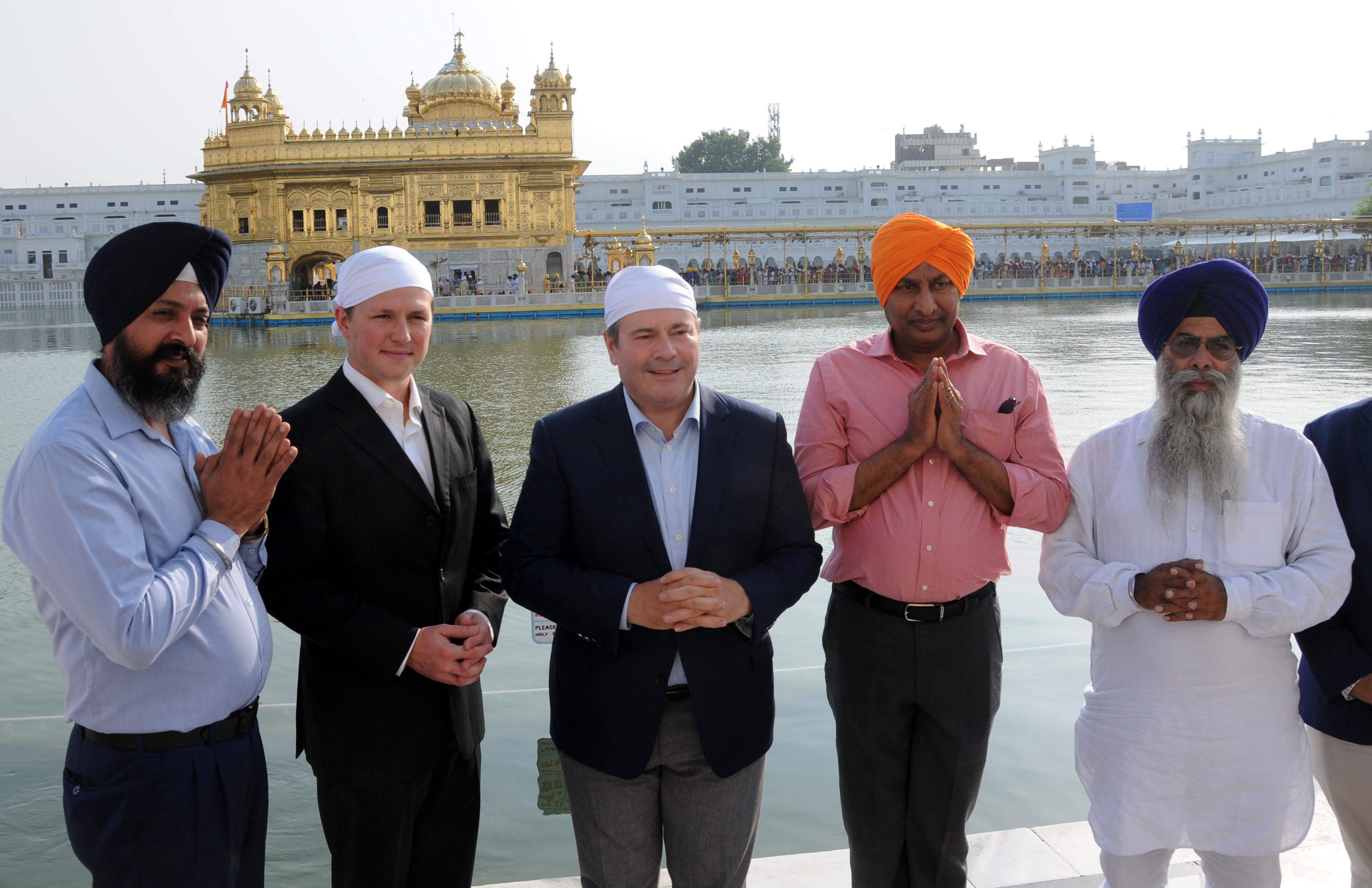 https://d3n8a8pro7vhmx.cloudfront.net/prasadpanda/pages/13/features/original/Golden_Temple_with_Devin_Dreeshen_and_Jason_Kenney.jpg?1545339969