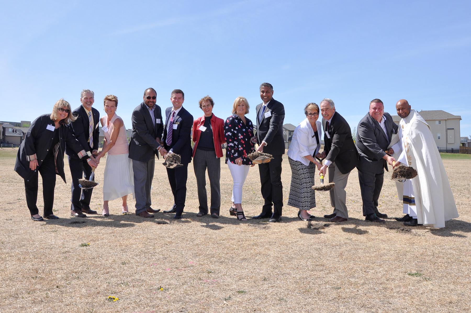 https://d3n8a8pro7vhmx.cloudfront.net/prasadpanda/pages/13/features/original/Sod_Turning_at_the_new_Catholic_School_in_Sherwood.jpg?1525821843