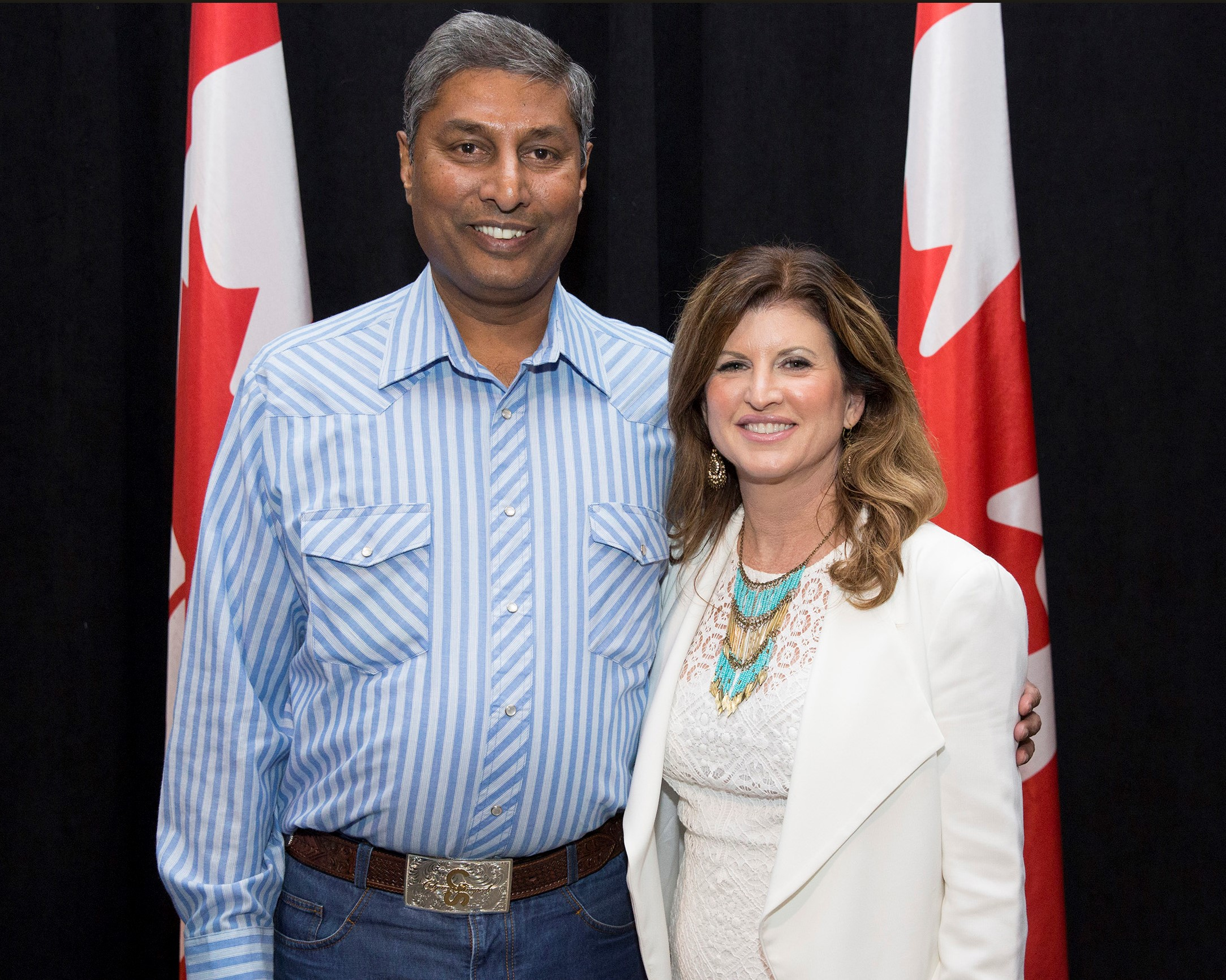 https://d3n8a8pro7vhmx.cloudfront.net/prasadpanda/pages/13/features/original/With_Rona_Ambrose_at_the_Stampede_Barbecue.jpg?1525822656