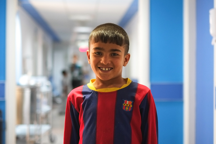 Young Mohammad, still waiting for lifesaving heart surgery, stands in the hallway of the new heart center in Nasiriyah, Iraq.