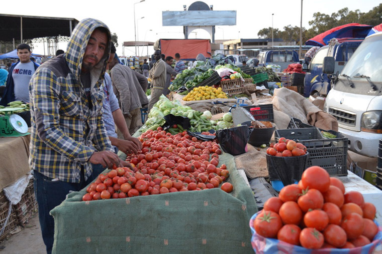 A vegetable stand in Benghazi remains open for now, though business is slow.
