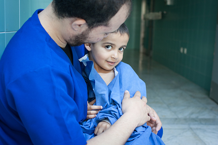 Hamam waits outside of the operating room, ready for his heart surgery.