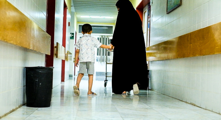 Hamam and his mom take a walk through the hospital corridor...his first since receiving lifesaving heart surgery!