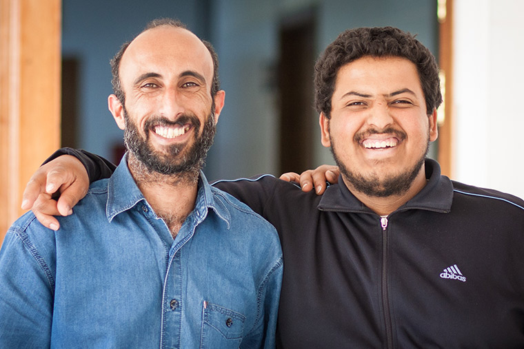 Rowabe and Mohammad's fathers have supported each other while waiting for their children to come out of the operating room.