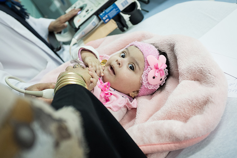 Rahma lays on an examination bed, as she receives an echocardiogram.