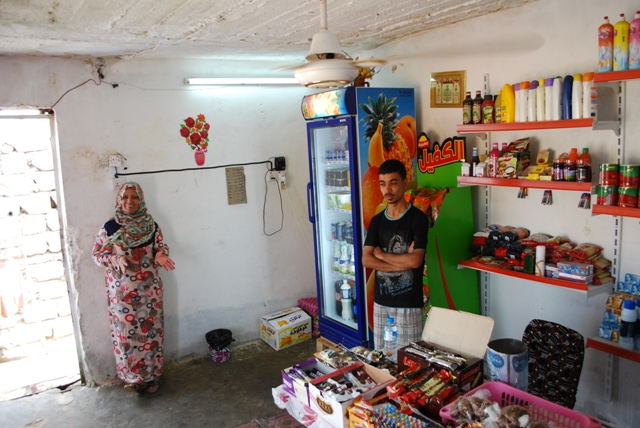 Abeer and her son proudly stand in their corner store. Initial financing for the small business came in the form of an Empowerment grant from Preemptive Love Coalition.