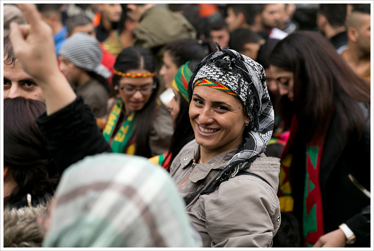 A woman stops to smile for the camera, during protests in Berlin against the terrorist group ISIS.