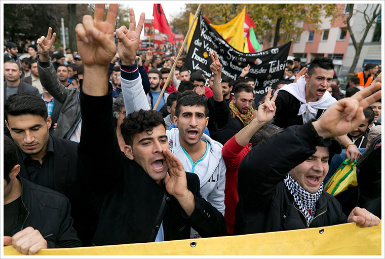 A crowd gathered to protest against ISIS in Berlin, Germany.
