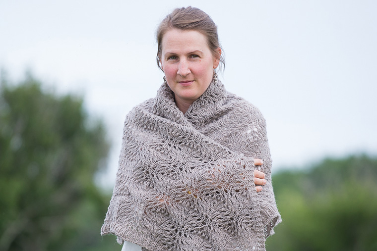 Ginny Sheller, wrapped up in the shawl she knit and used to raise funds for women and girls in Iraq.