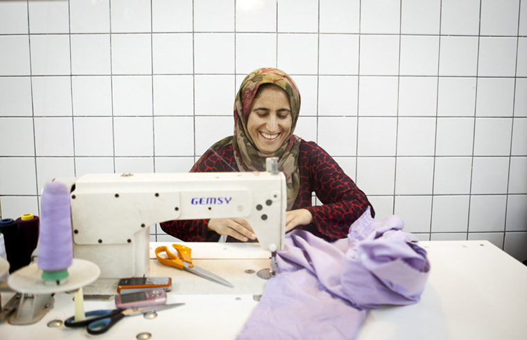 23/30  Chro (name changed) spends the long afternoons of Ramadan sewing and making clothes for women in the city. \