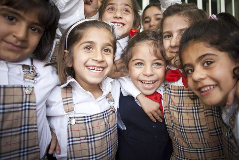 Deeya and her friends at school, beaming smiles, being kids—just as it should be.