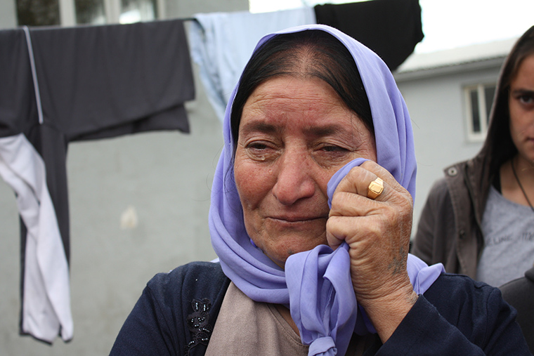 A Yezidi woman cries as she talks about the family members she's lost to ISIS, whether by kidnapping or death.