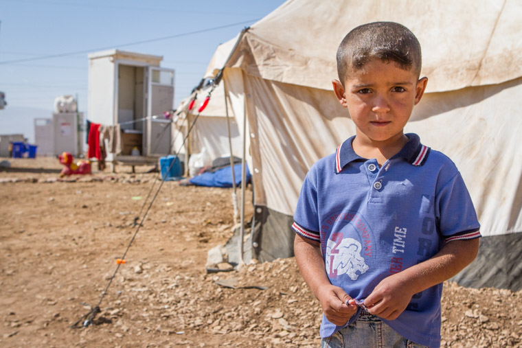 A young Syrian refugee tries to make a new life at the Arbat Camp, Iraq, 2013.